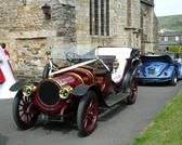 a vintage car being used at a wedding service