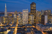 brightly lit cityscape of san francisco downtown in the late evening