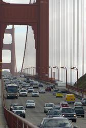 looking along the golden gate bridge traffic crossing on highway 1, california