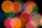 colourful and dreamy light effect created using christmas lights and 50mm prime lens