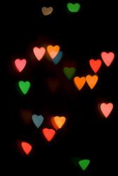 colourful bokeh light shape created using a cutout loveheart mask