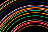 colourful light trails create a neon style background