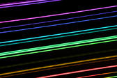 colourful lines of light, long exposure painting with light image composed of rainbow colours