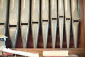 close up on the organ pipes of a small church organ