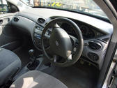 looking into a car interior, steering wheel and instrument cluster, right hand drive car