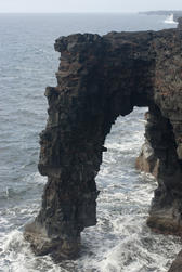 black volcanic rock arch at Holei on the coast of Hawaiis Big Island