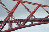 a telephoto zoom image of the train on the forth bridge