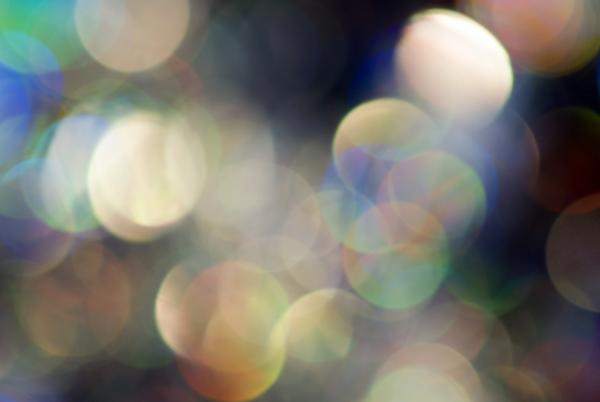 a dreamy abstract hazy light backgrop created with lens bokeh and chromatic aberration image