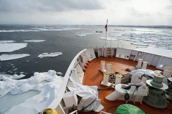 Bows of the Aurora icebreaker clearing a channel for shipping through the winter drift ice in the ocean off Hokkaido