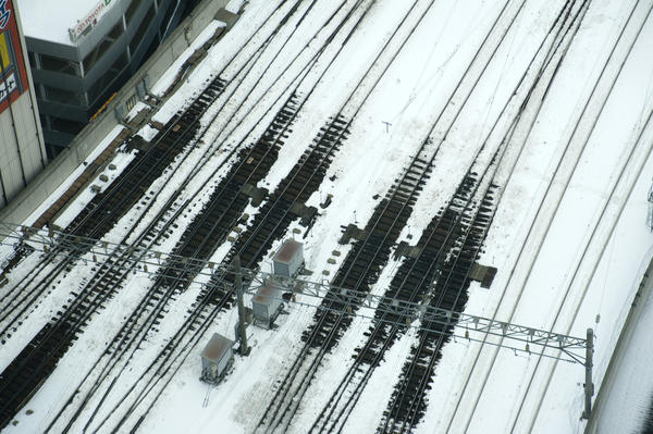 Railway lines in winter with snow melted around electrically heated points