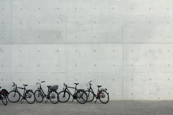 Commuter bicycles parked in a row outside a commercial building as people opt for a cheaper eco-friendly mode of transport