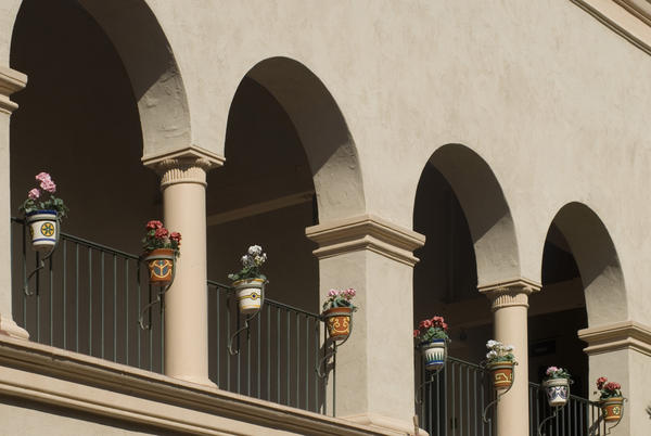 court yard in the spanish colonial style with arcade or decorative planters