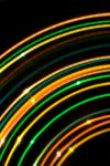 arcs of colourful light with an orange and green palette