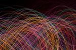 weaving and intertwined curved lines of light on a black background
