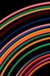 a neon style backdrop of arcs from concentric circles