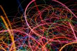 weaving and intertwined lines of light of varying thicknesses